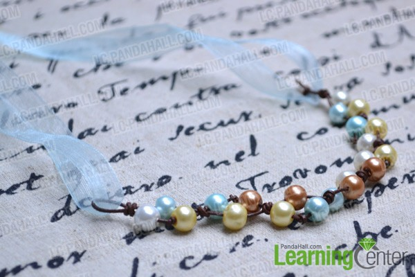 Finally the knotted pearl necklace looks like: