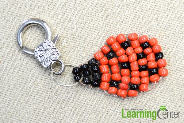 finish making the beaded beetle keychain