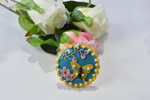 final look of the blue felt butterfly and flower brooch