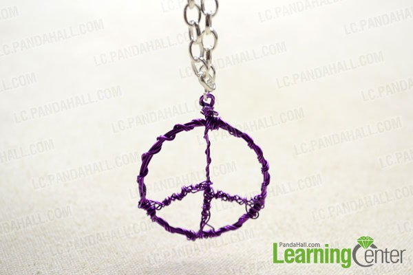 finished wire wrapped peace sign pendant