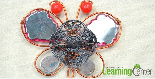 attach iron brooch finding to butterfly